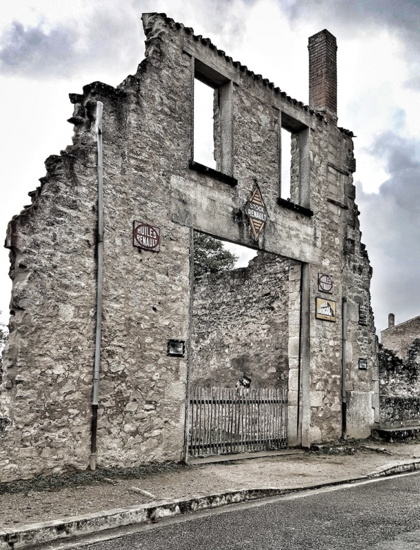Oradour Garage with signs in tact