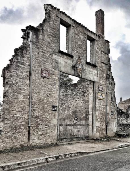 Oradour Garage with signs in tact, Oradour sur Glane, France