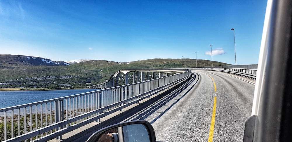 Driving across Bensholmen Bridge, Tromso city, Norway