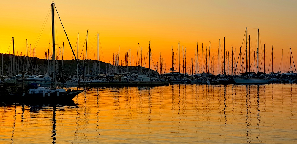 Izola sunset boats